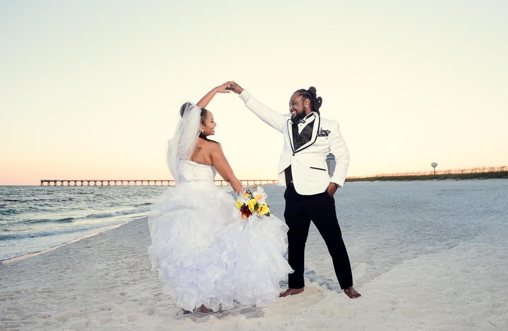 Groom spinning Bride on the beach at sunset, high low wedding dress, Royal Red Destination Wedding, Florida wedding photographer, Lazzat Photography
