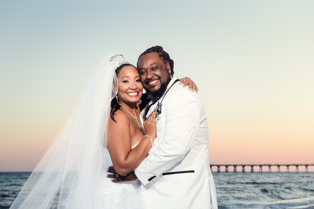 Bride and Groom smiling at the camera on the beach at sunset, Royal Red Destination Wedding, Florida wedding photographer, Lazzat Photography