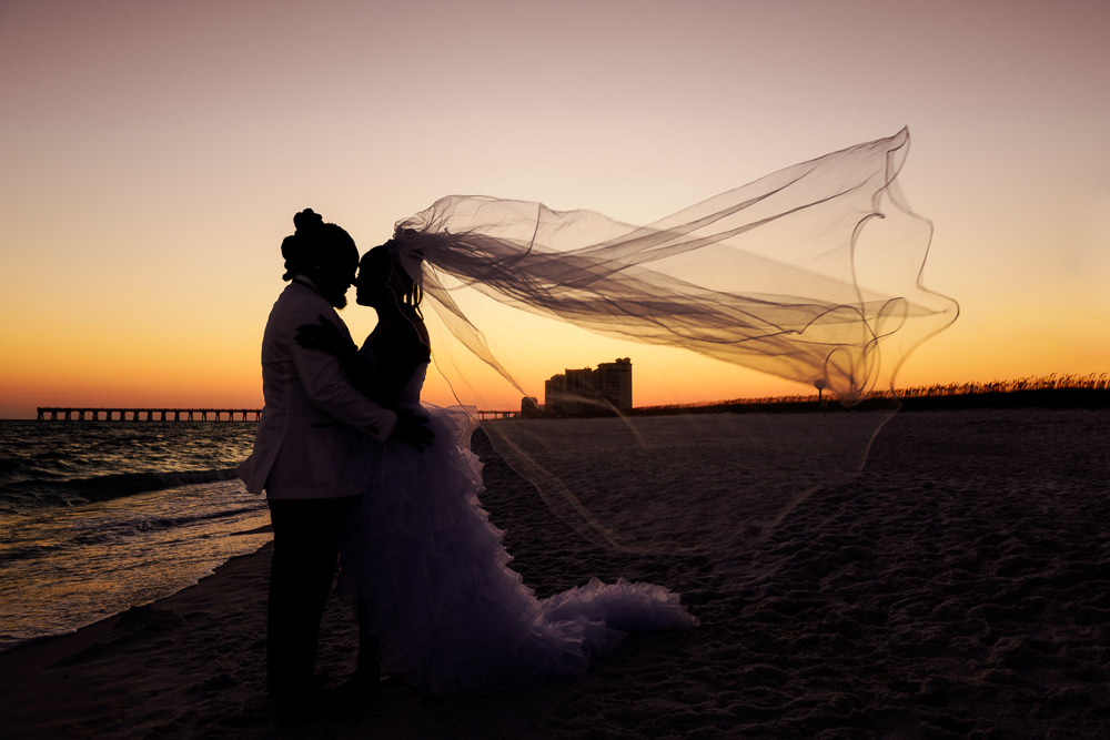 Silhouette of Bride and Groom with veil flying on the beach at sunset, Royal Red Destination Wedding, Florida wedding photographer, Lazzat Photography