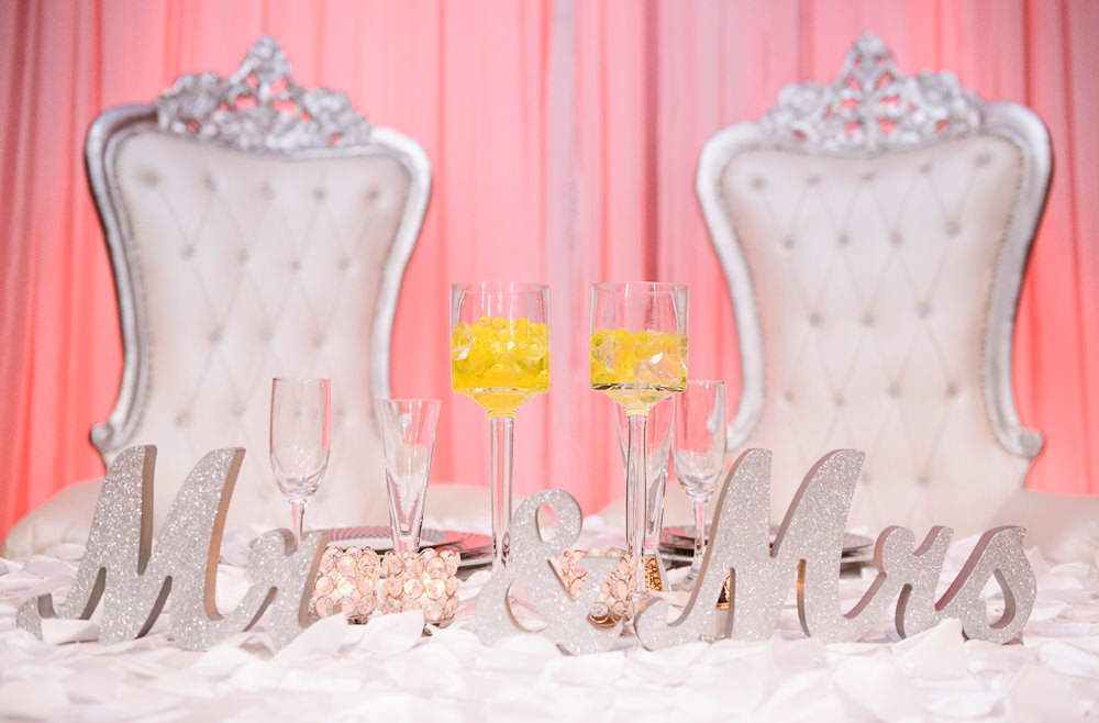 Bride and Groom's sweetheart table, reception at the event room, Royal Red Destination Wedding, Florida wedding photographer, Lazzat Photography