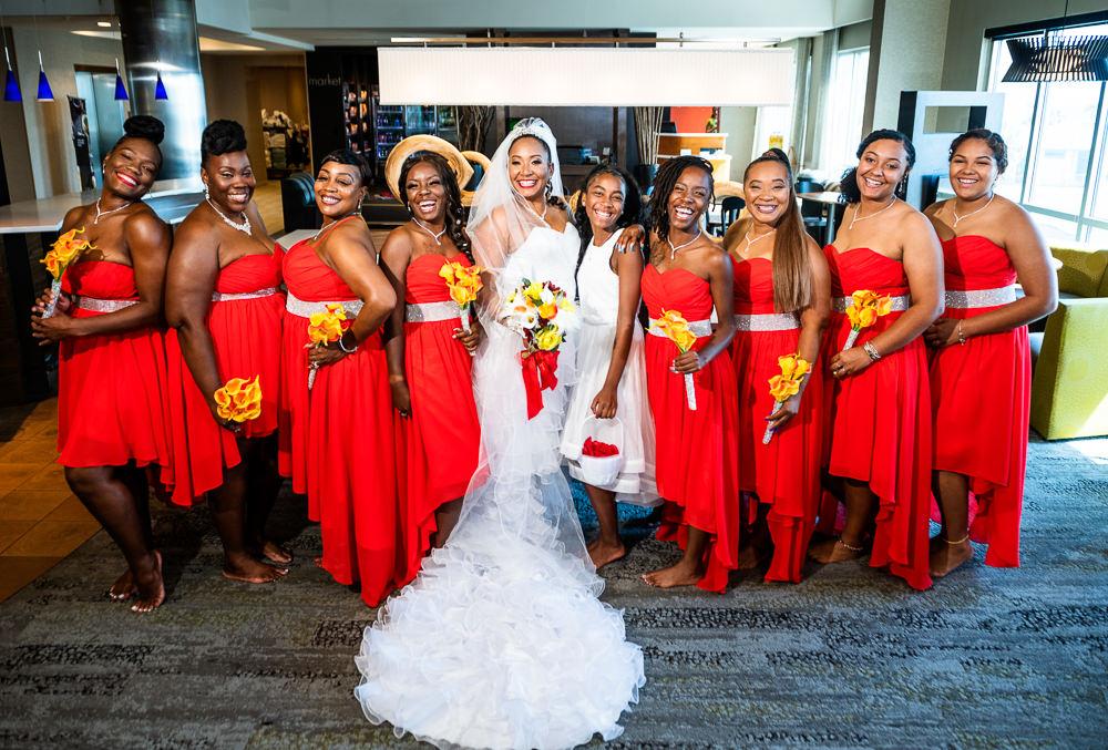 Bride posing with her Bridesmaids, red bridesmaid dresses, high low wedding dress, Royal Red Destination Wedding, Florida wedding photographer, Lazzat Photography