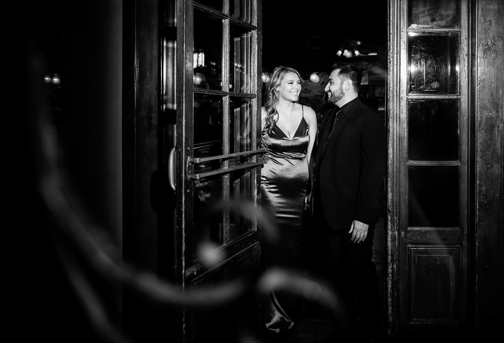 Couple walking into Seville Quarter, New Orleans Inspired Engagement Session, Long red gown, Pensacola engagement photographer, Lazzat Photography