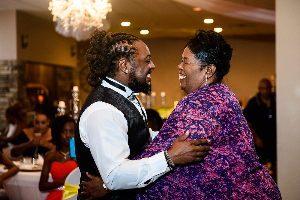 Groom dancing with his aunt during the reception at the event room, Royal Red Destination Wedding, Florida wedding photographer, Lazzat Photography