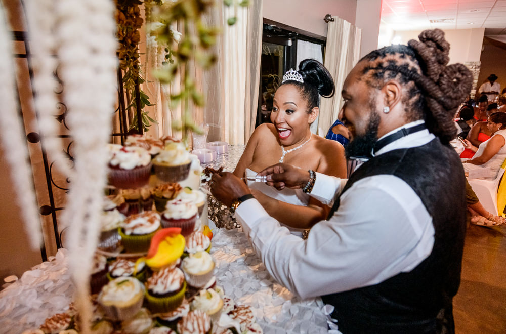 Bride and Groom cutting their cake during their reception at the event room, Royal Red Destination Wedding, Florida wedding photographer, Lazzat Photography
