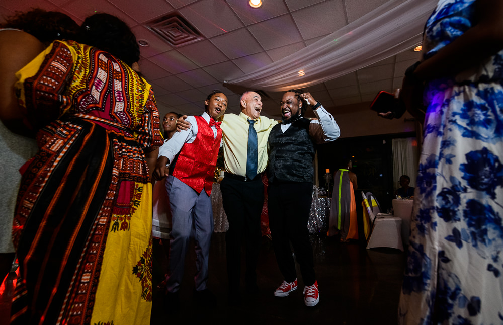 Groom dancing with guests during their reception at the event room, Royal Red Destination Wedding, Florida wedding photographer, Lazzat Photography