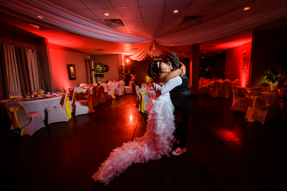 Bride and Groom hugging at the end of their reception at the event room, Royal Red Destination Wedding, Florida wedding photographer, Lazzat Photography