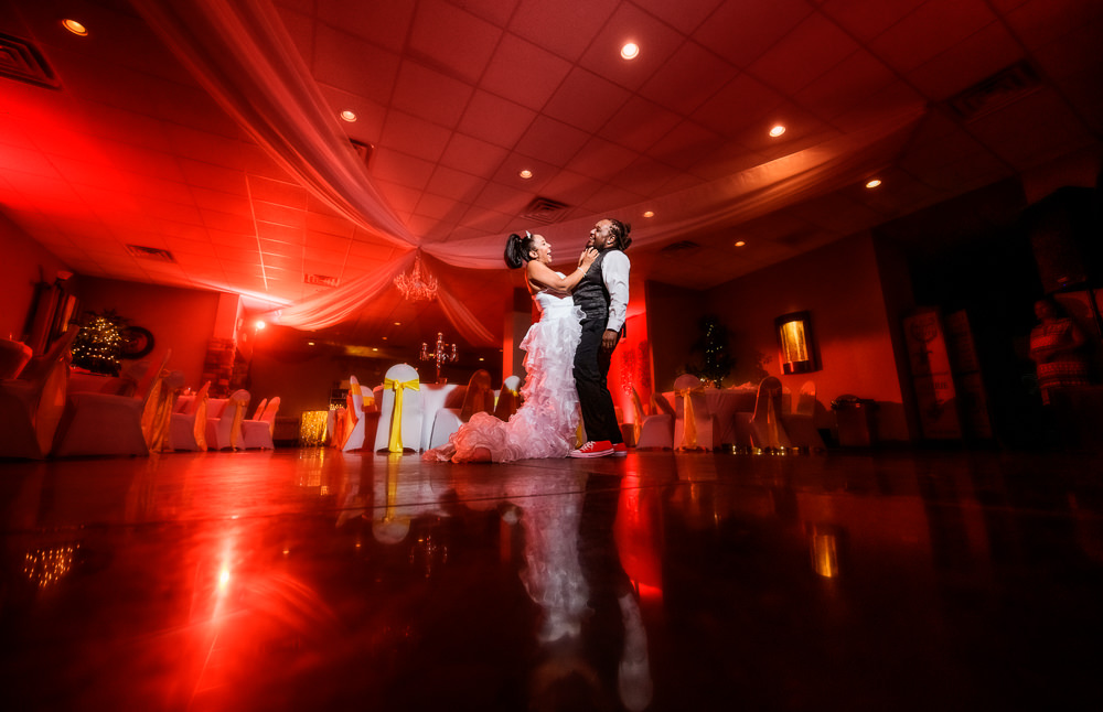 Bride and Groom laughing at the end of their reception at the event room, Royal Red Destination Wedding, Florida wedding photographer, Lazzat Photography