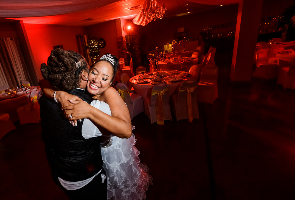 Close up of Bride and Groom hugging at the end of their reception at the event room, Royal Red Destination Wedding, Florida wedding photographer, Lazzat Photography
