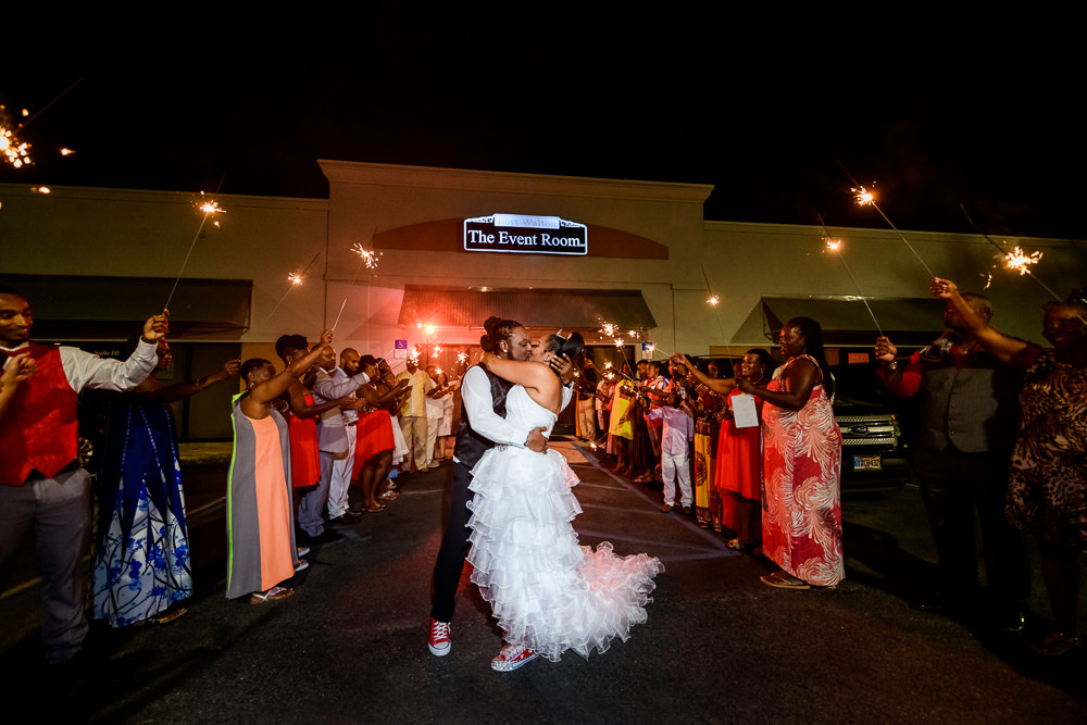 Bride and Groom kissing at the end of their sparkler exit at the event room, Royal Red Destination Wedding, Florida wedding photographer, Lazzat Photography