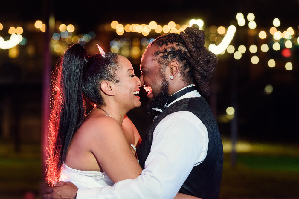 Bride and Groom laughing at night with twinkle lights, Royal Red Destination Wedding, Florida wedding photographer, Lazzat Photography