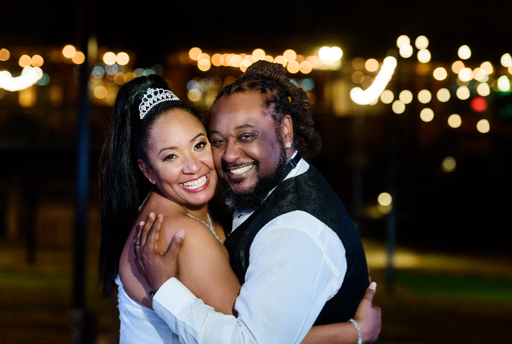 Bride and Groom smiling at night with twinkle lights, Royal Red Destination Wedding, Florida wedding photographer, Lazzat Photography