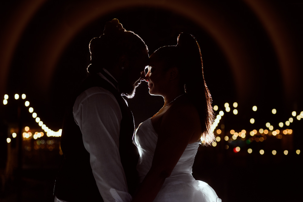 Bride and Groom forehead to forehead at night with twinkle lights, Royal Red Destination Wedding, Florida wedding photographer, Lazzat Photography