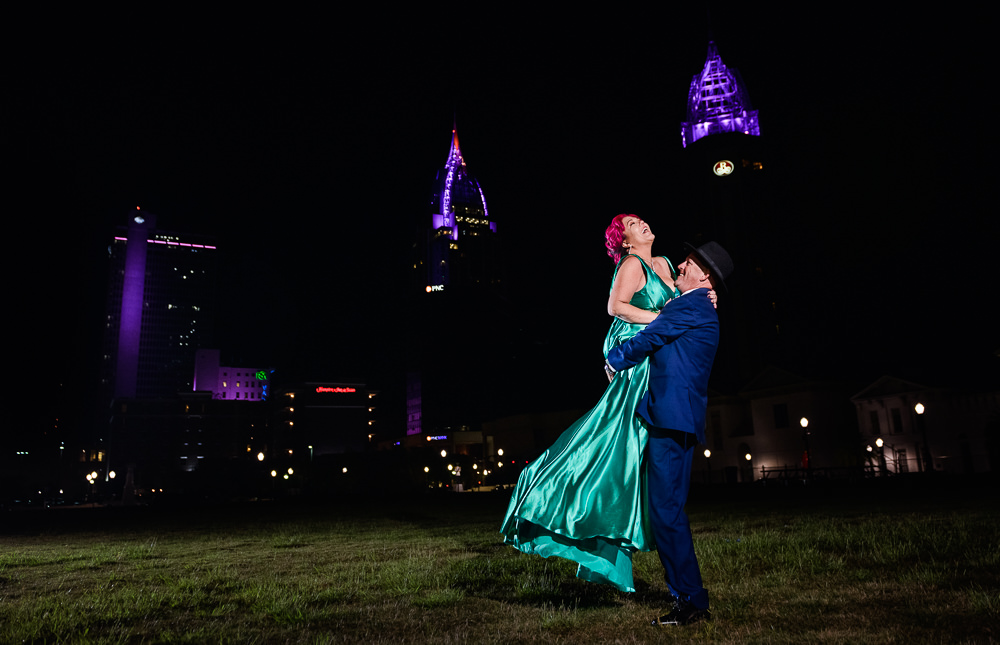 Man picking up women, couple spinning, Mobile skyline, green formal gown, pink hair, EPIC couple shoot, Lazzat Photography