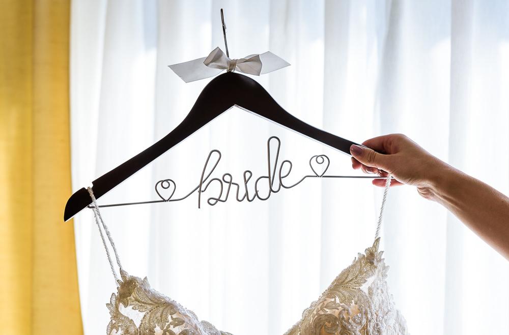 Bride wedding dress hanger, Skopelos at New World, Palafox Wharf Pensacola Wedding, Orlando Florida Wedding photographer, Lazzat Photography