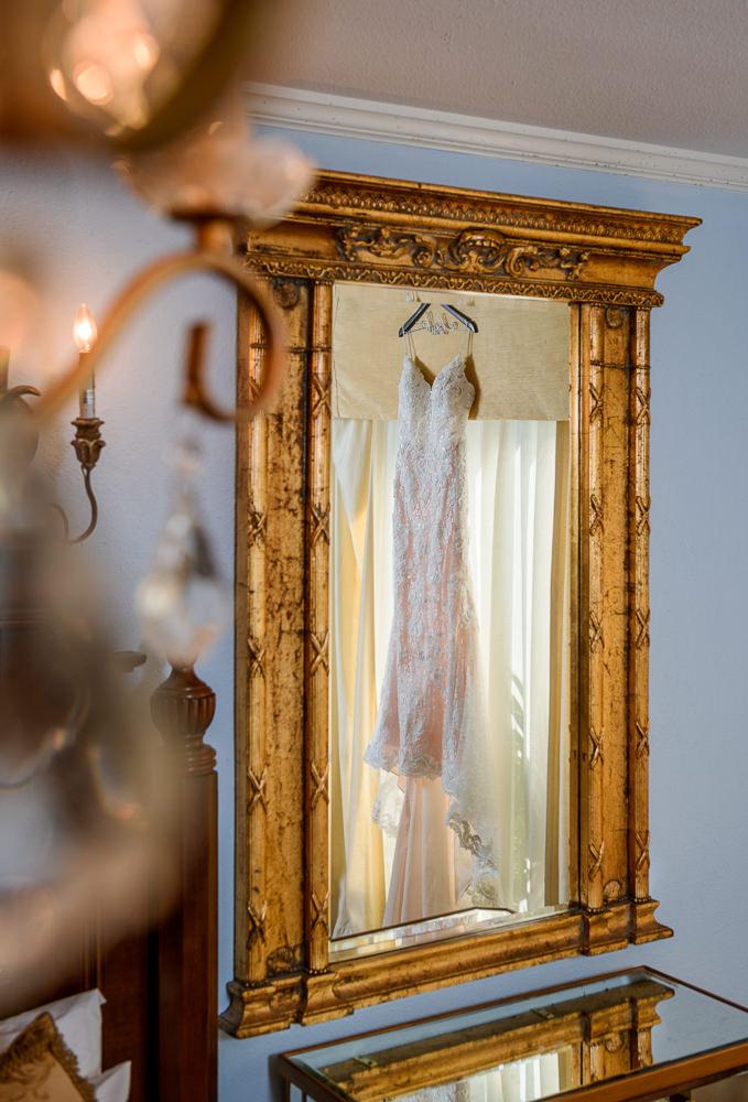 Lace wedding dress and veil reflection in ornate gold mirror, Skopelos at New World, Palafox Wharf Pensacola Wedding, Orlando Florida Wedding photographer, Lazzat Photography
