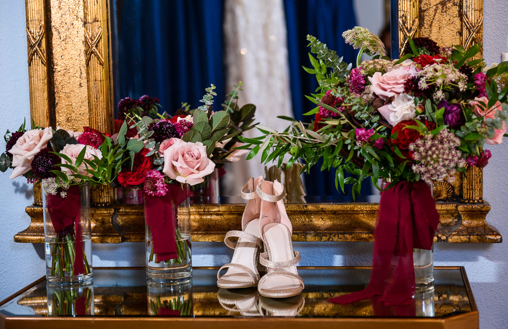 Bride's shoes and pink and red flowers on mirrored table, Skopelos at New World, Palafox Wharf Pensacola Wedding, Orlando Florida Wedding photographer, Lazzat Photography