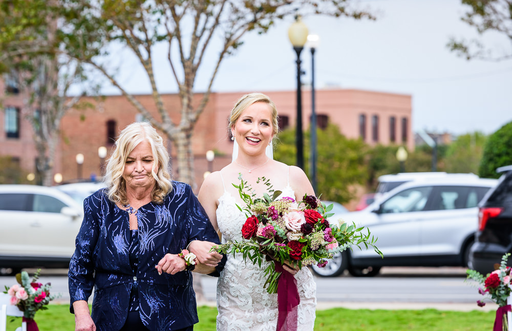 Bride's mom walking her down the aisle, Palafox Wharf waterfront, Palafox Wharf Pensacola Wedding, Orlando Florida Wedding photographer, Lazzat Photography