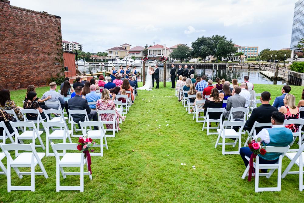 Bride and Groom's waterfront wedding ceremony, Palafox Wharf waterfront, Palafox Wharf Pensacola Wedding, Orlando Florida Wedding photographer, Lazzat Photography