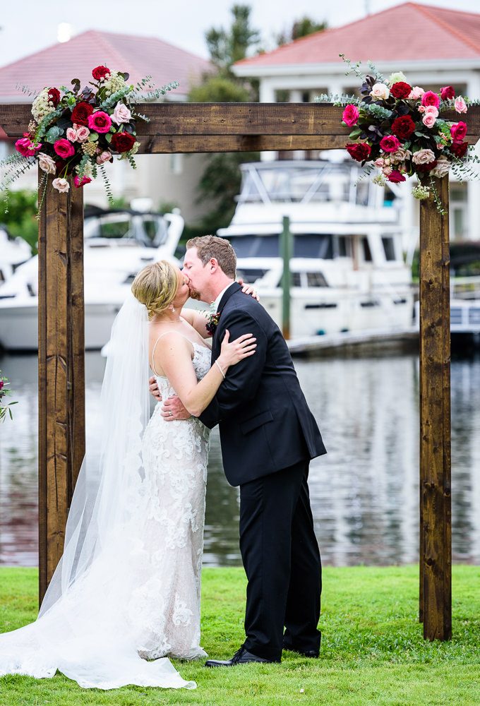 Bride and Groom's first kiss, long lace veil, lace wedding dress, Palafox Wharf waterfront, Palafox Wharf Pensacola Wedding, Orlando Florida Wedding photographer, Lazzat Photography