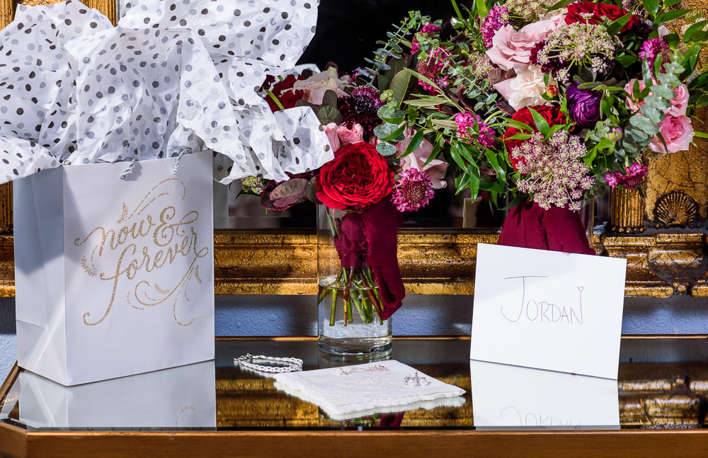 Bride's details, flowers and groom's gift on a mirrored table, pink and red flowers, Skopelos at New World, Palafox Wharf Pensacola Wedding, Orlando Florida Wedding photographer, Lazzat Photography