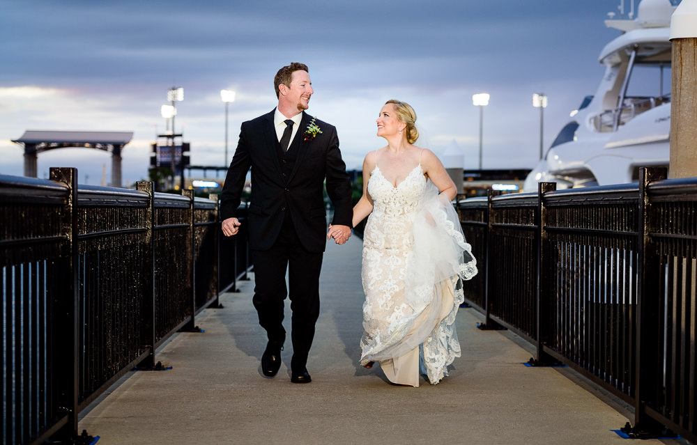 Bride and Groom running down Palafox pier, Palafox Wharf Pensacola Wedding, Orlando Florida Wedding photographer, Lazzat Photography