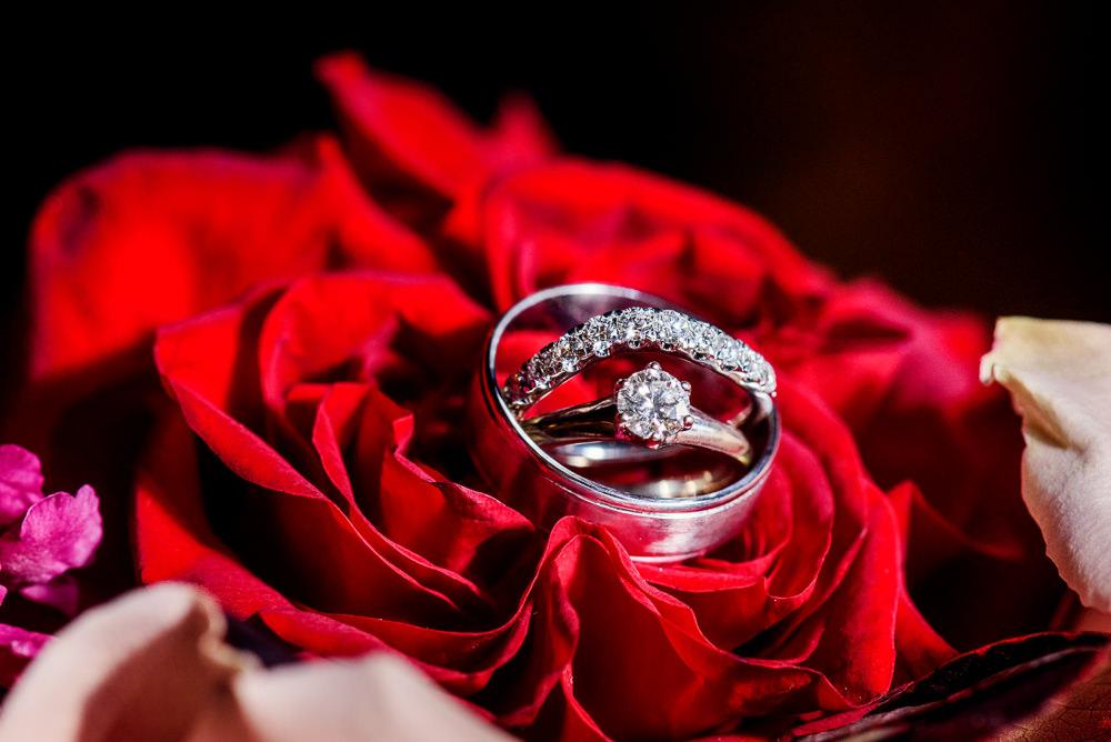 Bride and Groom's wedding rings in a rose, Palafox Wharf Pensacola Wedding, Orlando Florida Wedding photographer, Lazzat Photography