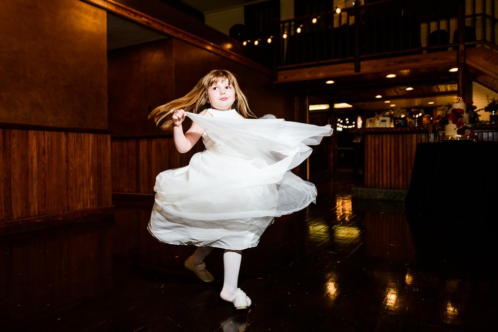 Flower girl dancing, Palafox Wharf Pensacola Wedding, Orlando Florida Wedding photographer, Lazzat Photography