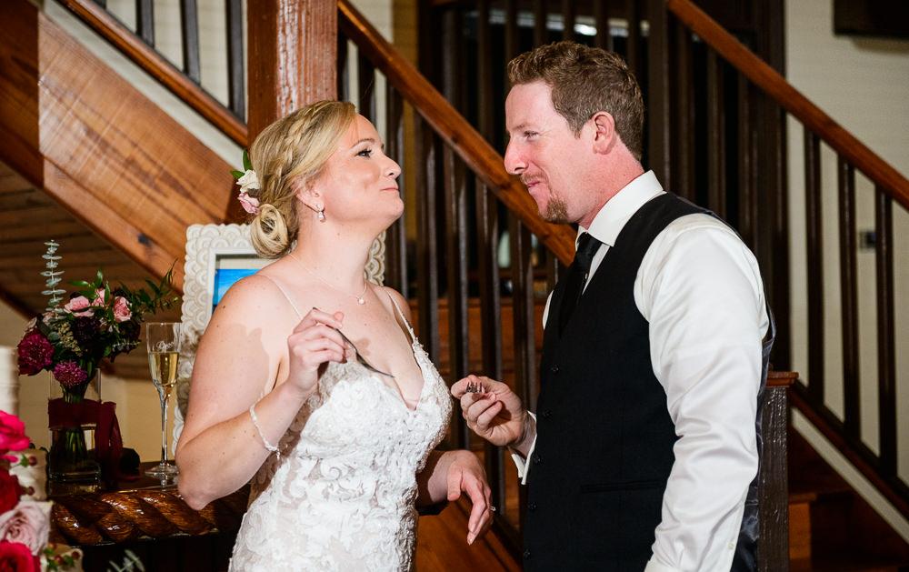 Bride and Groom eating their wedding cake, Palafox Wharf Pensacola Wedding, Orlando Florida Wedding photographer, Lazzat Photography