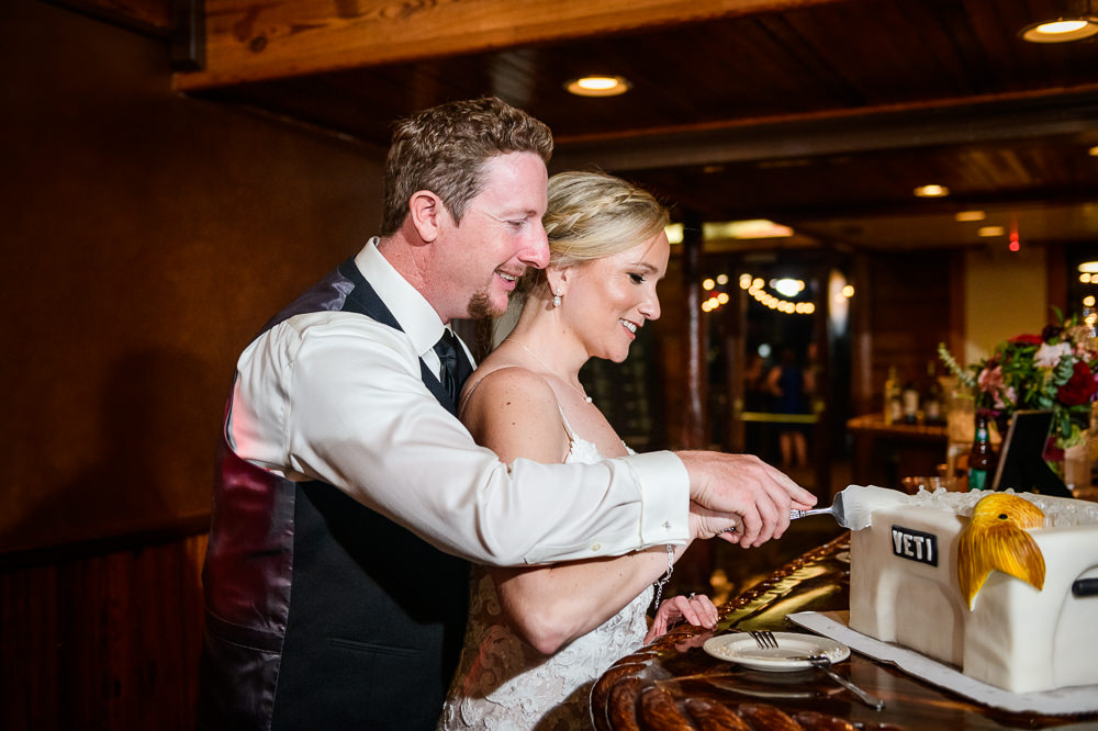 Bride and Groom cutting the Groom's yeti cooler fish cake, Palafox Wharf Pensacola Wedding, Orlando Florida Wedding photographer, Lazzat Photography
