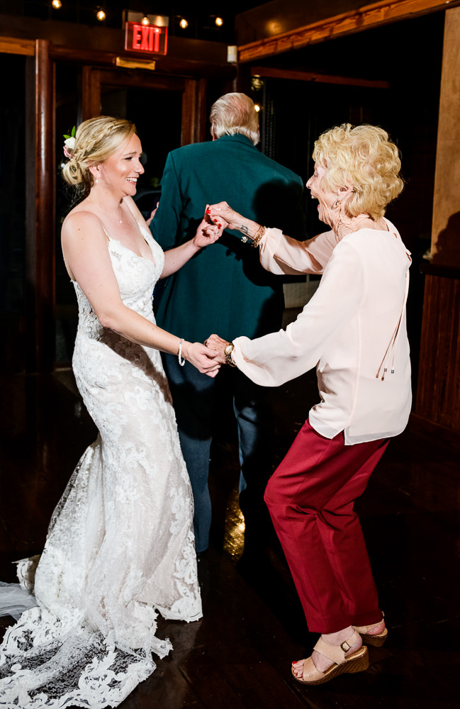 Bride dancing with grandma, Palafox Wharf Pensacola Wedding, Orlando Florida Wedding photographer, Lazzat Photography