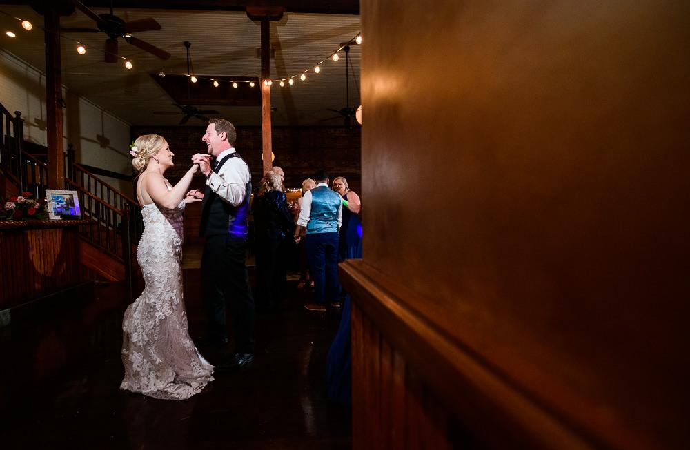 Bride and Groom dancing during their reception, Palafox Wharf Pensacola Wedding, Orlando Florida Wedding photographer, Lazzat Photography