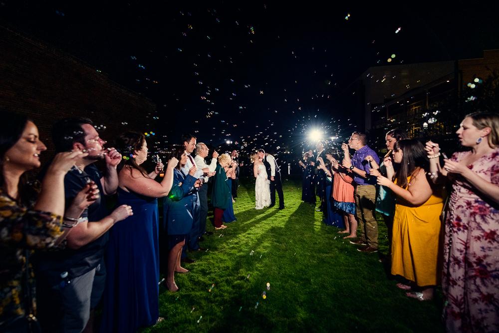 Bride and Groom kiss during bubble grand exit, Palafox Wharf Pensacola Wedding, Orlando Florida Wedding photographer, Lazzat Photography