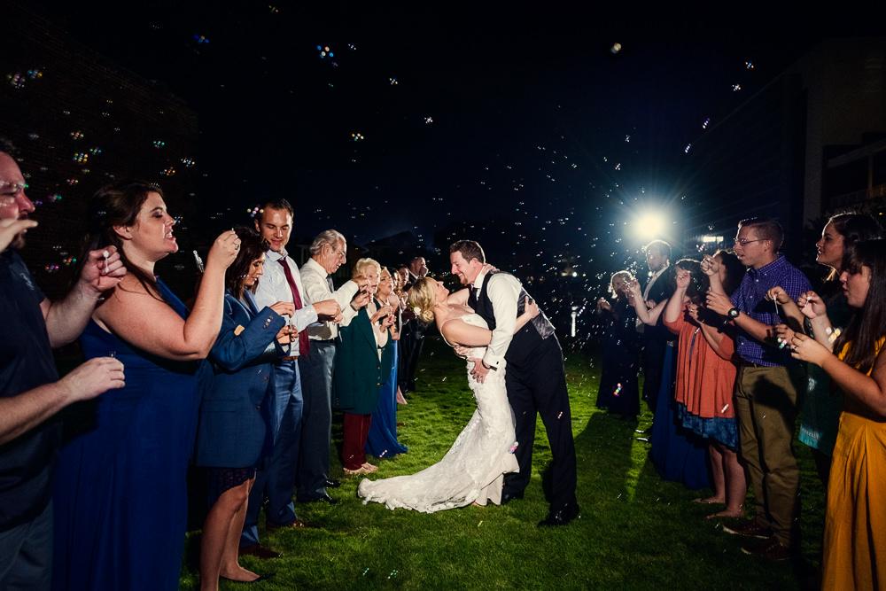Bride and Groom dip during bubble grand exit, Palafox Wharf Pensacola Wedding, Orlando Florida Wedding photographer, Lazzat Photography