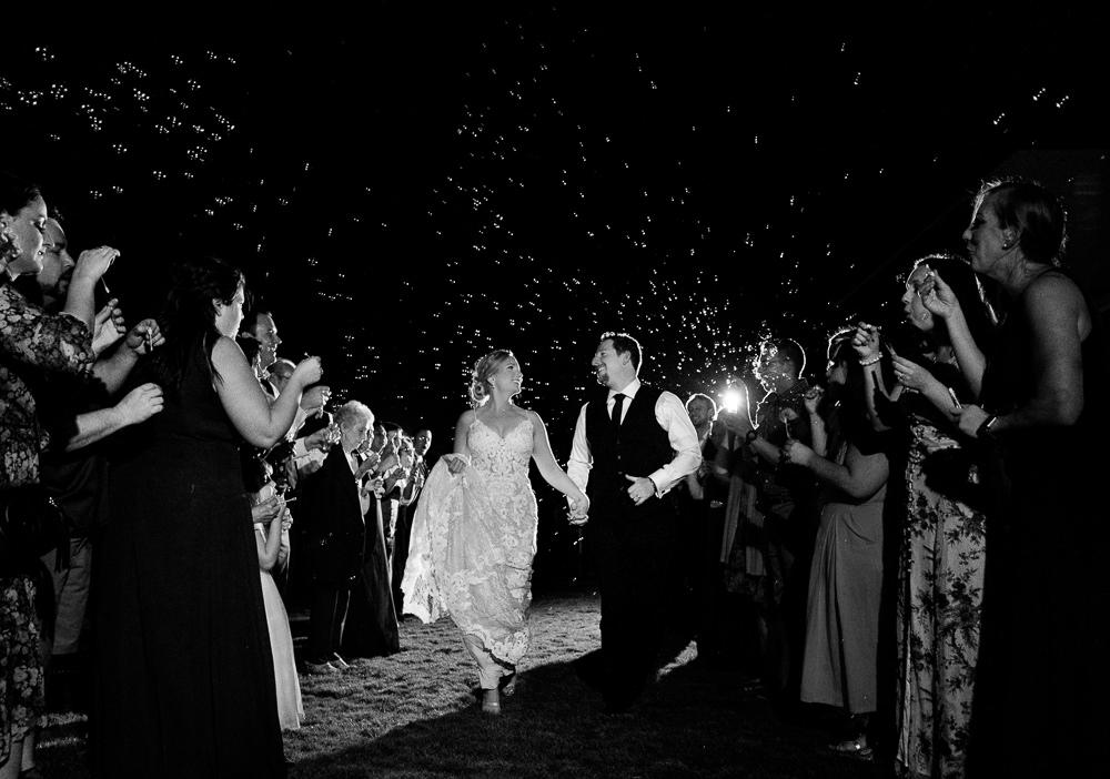 Bride and Groom running through bubbles during grand exit, Palafox Wharf Pensacola Wedding, Orlando Florida Wedding photographer, Lazzat Photography