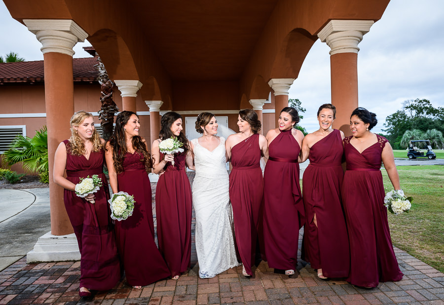 Bride walking with her Bridesmaids, burgundy bridesmaids dresses, lace wedding dress, multicultural filipino wedding, Catholic country club wedding, Pensacola Florida, Lazzat Photography
