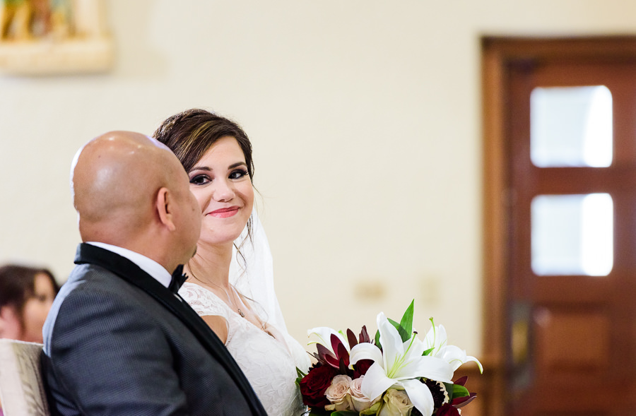 Bride smiling at her Groom during the wedding ceremony, multicultural filipino wedding, Catholic country club wedding, Pensacola Florida, Lazzat Photography