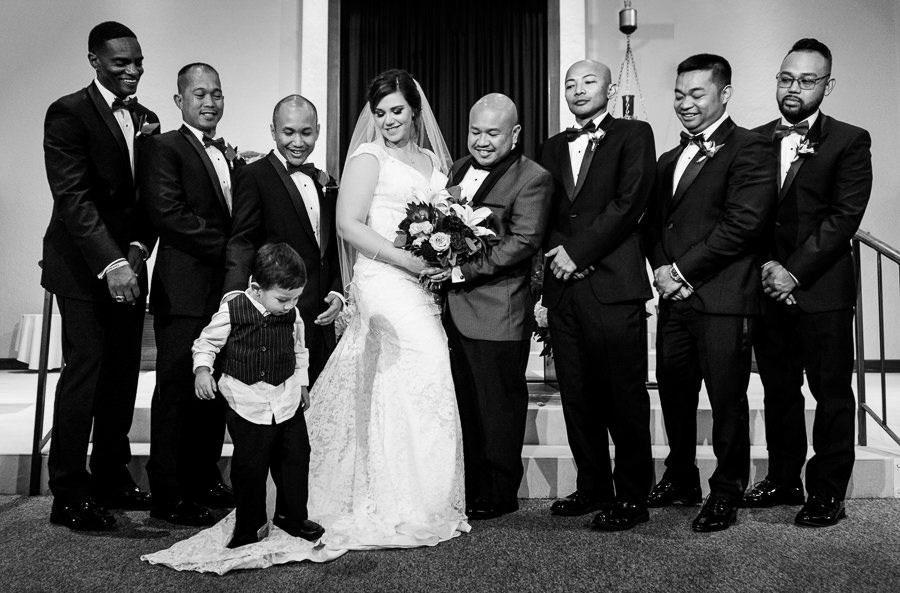 Bride and Groom with groomsmen and their son standing on mom's dress, multicultural filipino wedding, Catholic country club wedding, Pensacola Florida, Lazzat Photography