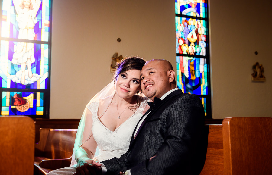 Bride and Groom sitting in the church with stained glass, multicultural filipino wedding, Catholic country club wedding, Pensacola Florida, Lazzat Photography
