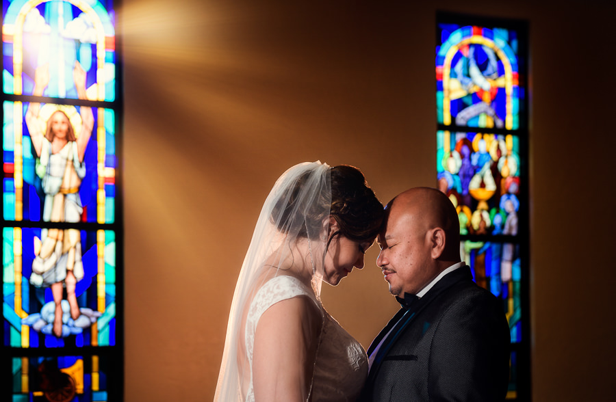 Bride and Groom head to head in the church with stained glass, multicultural filipino wedding, Catholic country club wedding, Pensacola Florida, Lazzat Photography