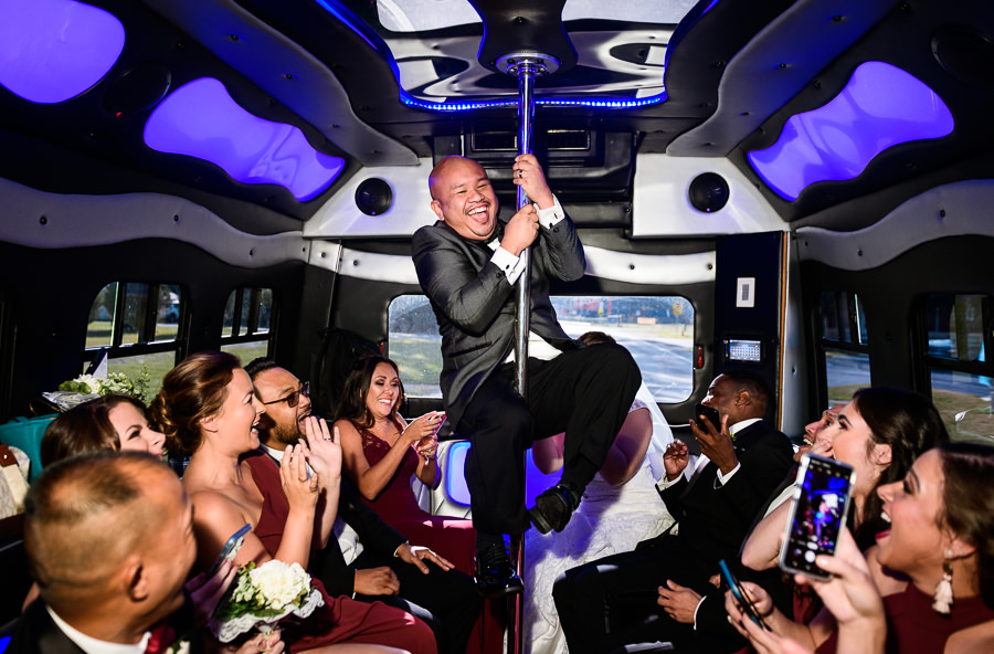 Groom dancing on the pole in the limo, multicultural filipino wedding, Catholic country club wedding, Pensacola Florida, Lazzat Photography