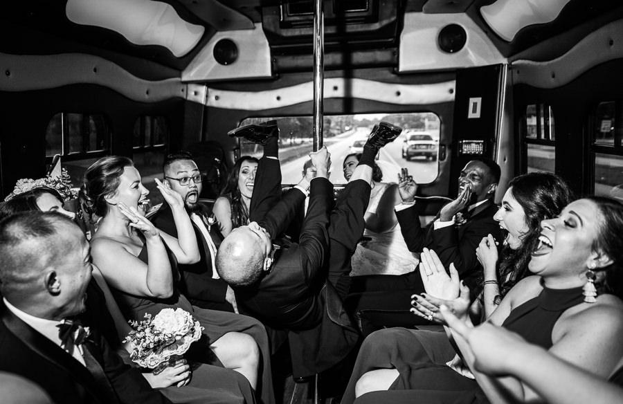 Groom dancing on the pole in the limo, black and white, multicultural filipino wedding, Catholic country club wedding, Pensacola Florida, Lazzat Photography