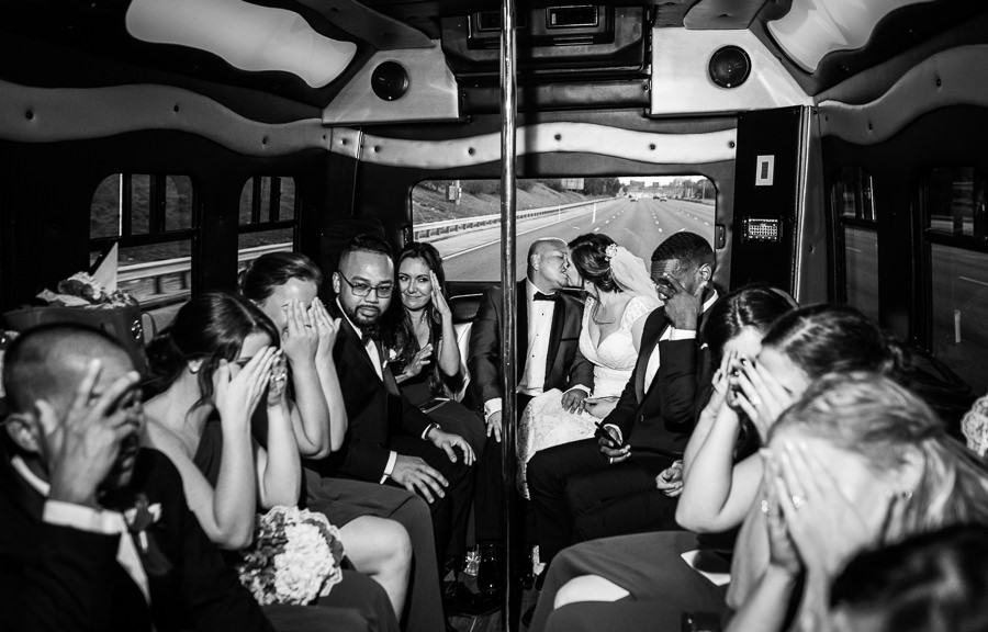 Bride and Groom kissing in the limo, black and white, multicultural filipino wedding, Catholic country club wedding, Pensacola Florida, Lazzat Photography