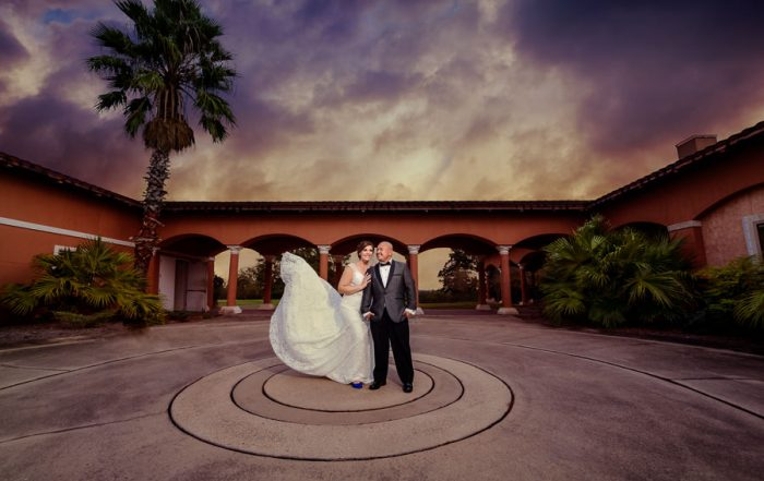 Bride and Groom dramatic sky with dress flying, Scenic Hills Country Club, multicultural filipino wedding, Catholic country club wedding, Pensacola Florida, Lazzat Photography