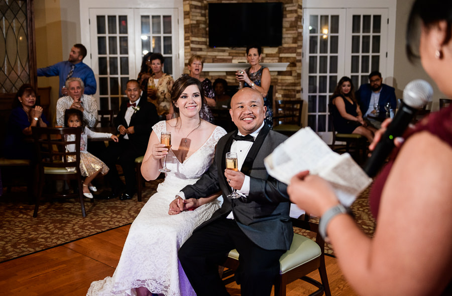 Bride and Groom smiling during the toasts, Scenic Hills Country Club, multicultural filipino wedding, Catholic country club wedding, Pensacola Florida, Lazzat Photography