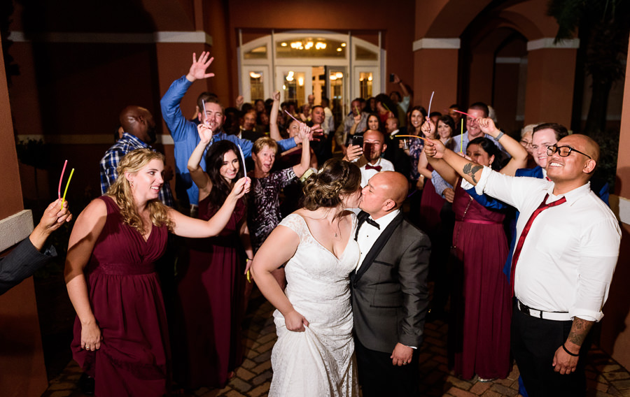 Bride and Groom kiss during glow stick exit, Scenic Hills Country Club, Catholic country club wedding, Pensacola Florida, Lazzat Photography