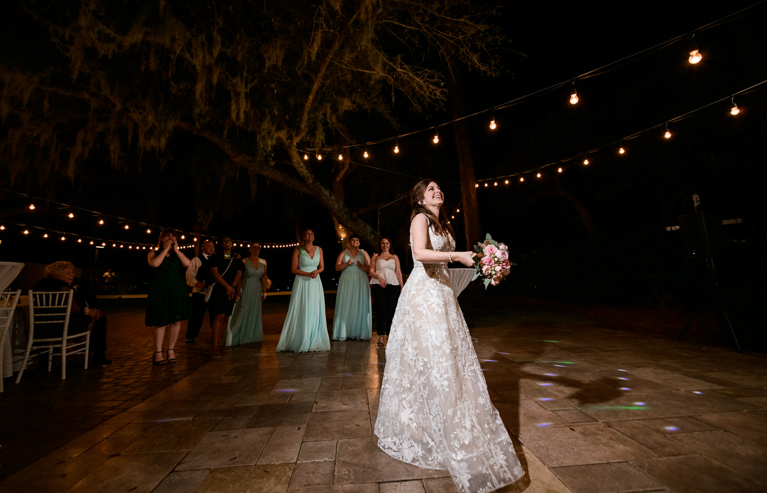Bouquet toss, lace wedding dress, blue Bridesmaid dresses, Destin Bay House Wedding, Destin Florida, Lazzat Photography, Florida wedding photographer, Orlando wedding photographer