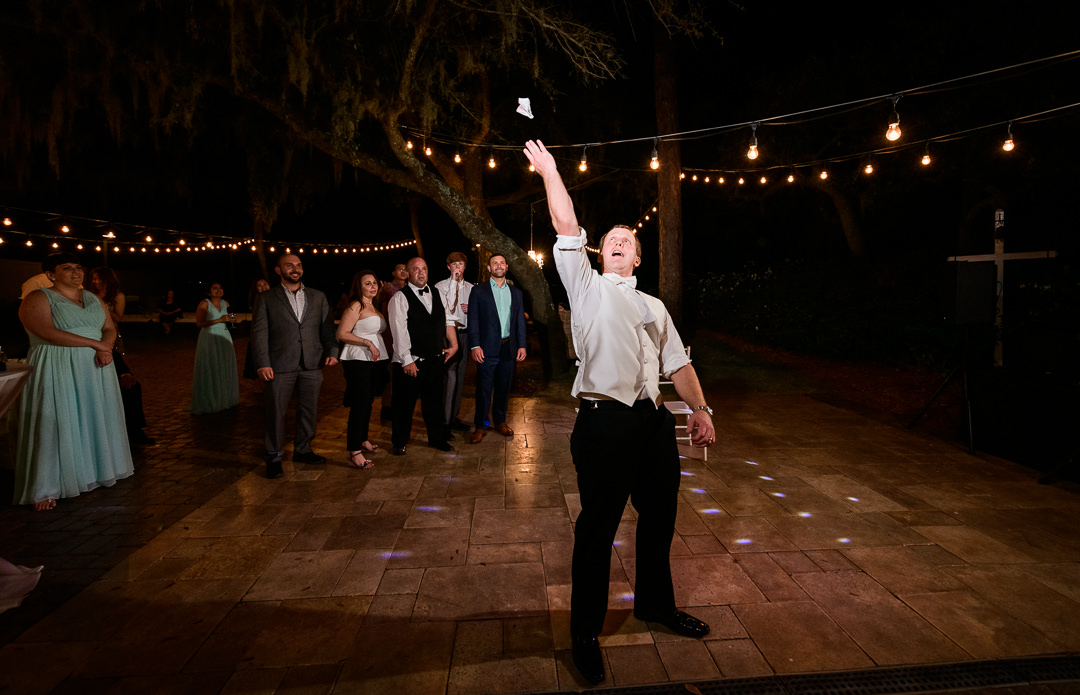 Groom throwing the garter, Destin Bay House Wedding, Destin Florida, Lazzat Photography, Florida wedding photographer, Orlando wedding photographer