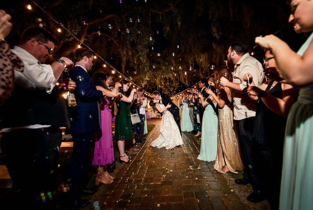 Bride and Groom kissing during their bubble grand exit, Destin Bay House Wedding, Destin Florida, Lazzat Photography, Florida wedding photographer, Orlando wedding photographer