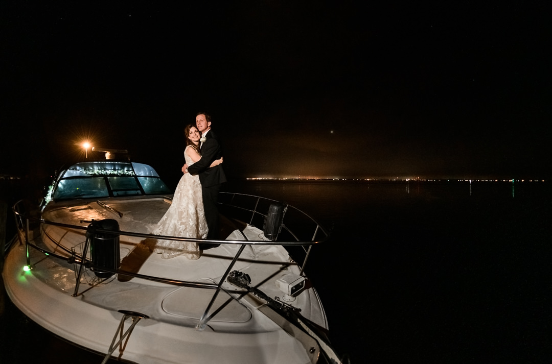 Bride and Groom on the boat after their grand exit, Destin Bay House Wedding, Destin Florida, Lazzat Photography, Florida wedding photographer, Orlando wedding photographer