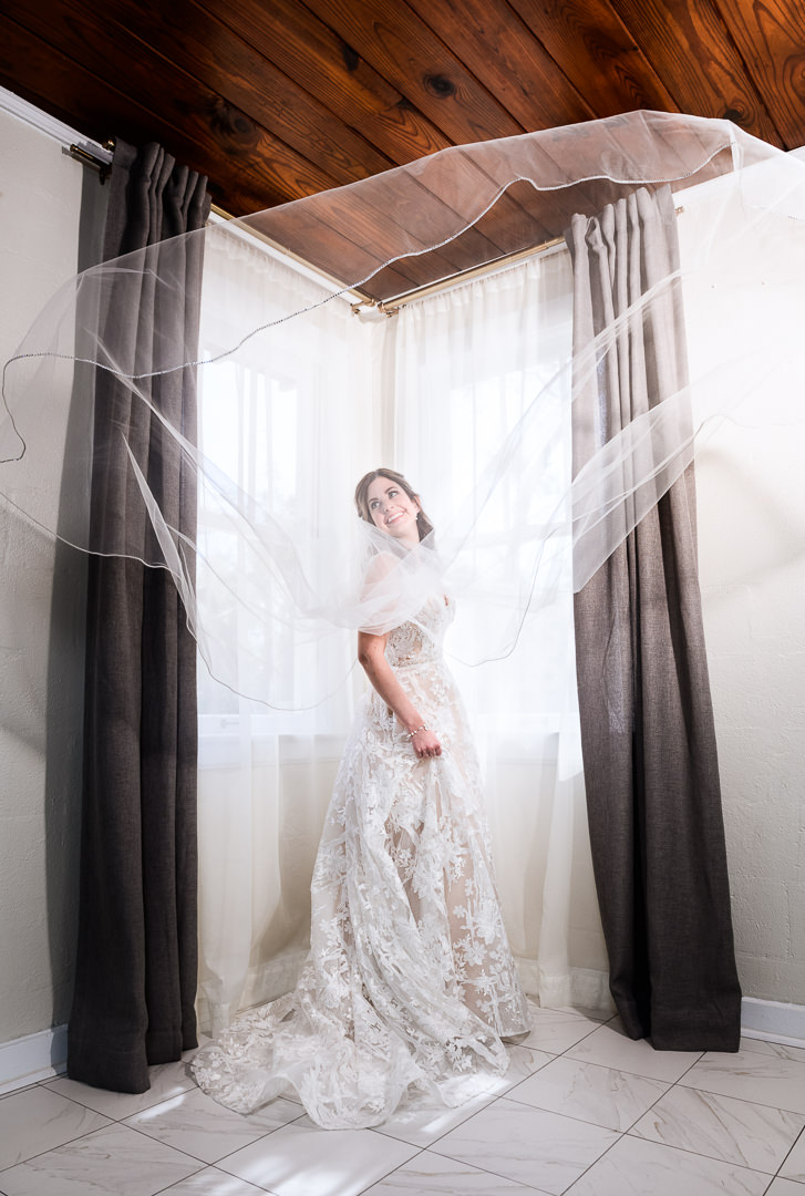 Bride with her veil flying at the Destin Bay House Wedding, Destin Florida, Lazzat Photography, Florida wedding photographer, Orlando wedding photographer